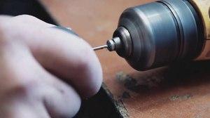 Чем расширить отверстие в металле